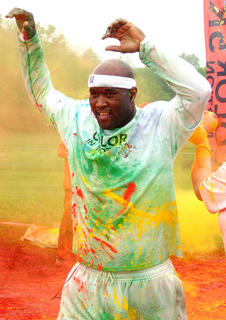 Anthony Epps prepares to be hit with another dose of colored powder.