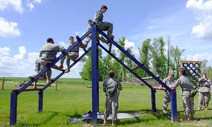 Cadets climb to the top of the Weaver, and then down the other side.