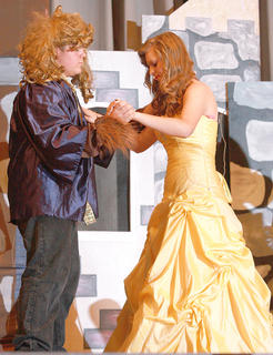 The Beast (Mathew Parker) and Belle (Leah Thompson) dance together as they start to fall in love.