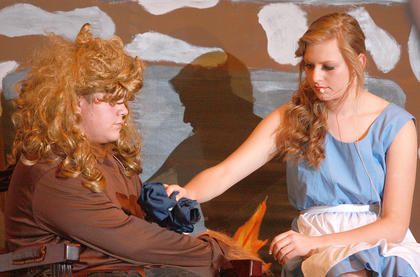 Back at the castle, Belle (Leah Thompson) tends to the Beast's (Mathew Parker) wounds after he saved her in the woods.