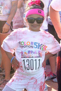 Niomi Coats, 5, of Georgetown isn't shy about participating in the Color in Motion 5K.