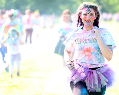 An estimated 1,300 people participated in the Color in Motion 5K on May 17 in Lebanon. This is the second time the event was held in Marion County, and by the end of the race, the participants were covered in an array of colors. This color-covered participant runs to the camera as she nears the end of the run.