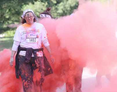 Participants walk through a cloud of red.