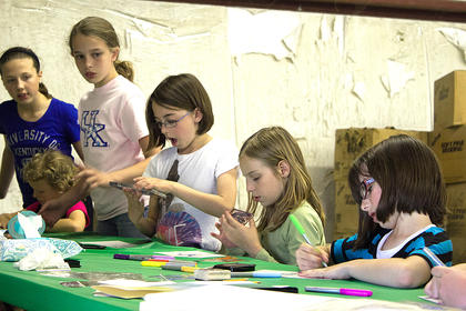 Children participate in arts and crafts activities.