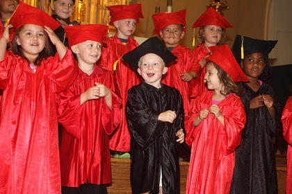 Hope Dougherty's pre-school class sings a special song before receiving their diplomas. They are, front row from left, Madison Mattingly, Alex Smith, Aiden Tatum, Kendall Thompson and JaDayol Thornton; back row from left, are Lane Buckman, John Richard Edelen, Mario Hernandez and Kylee Hickey.
