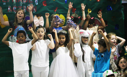 Students danced and sang together as they showed off their knowledge of the alphabet.