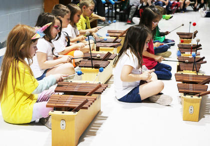 """Students performed on the xylophone to represent the letter """"X""""."""