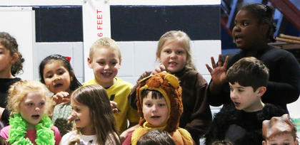 Rawr! Students flashed their best claws during the performance.