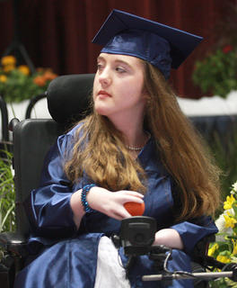 New graduate Amanda Atwood looks into the crowd after receiving her diploma.
