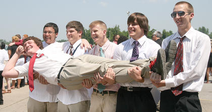 Curt Nalley gets held up by Dakota Sims, Jeremy Mattingly, Blair Gorley, Clark Spalding and David Hamilton after Saturday's graduation ceremony.