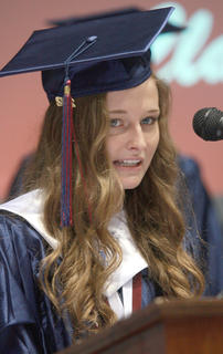 Ann Claire Thomas delivers the invocation during the graduation ceremony.