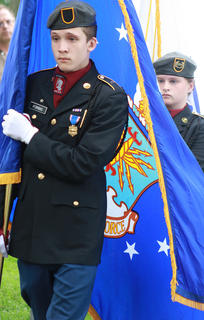 Hundreds of people gathered at Lebanon National Cemetery Sunday afternoon for the annual Memorial Day program. Christian Forbis of the Marion County JROTC carries the flag of the U.S. Air Force during the opening of the Memorial Day program. Behind him, Lindin Mattingly carries the Coast Guard flag.