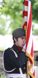 John Cox of the Marion County JROTC carries the American flag with as part of the color guard.