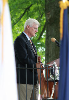 Rev. Steve Skaggs of Muldraugh Hill Baptist Church delivers the invocation during Sunday's ceremony.