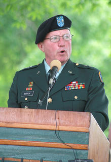 """Major General William E. Barron delivers the keynote address during Sunday's program. He told the crowd that the United States has more veterans now than at any time since the end of the Vietnam War, but he said Americans have been willing to stand up for liberty since the start of the nation. """"When freedom calls, we answer,"""" Barron said."""