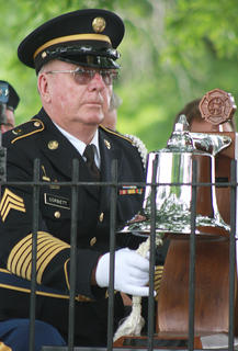 Bill Corbett of the Marion County Veterans Honor Guard rings a bell to honor each Marion County veterans who died serving in the military.