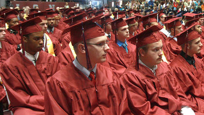 Graduates sit attentively during the speakers' remarks at the opening of the ceremony.