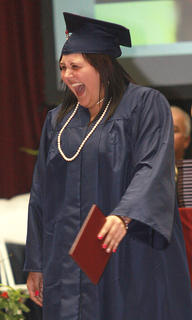 Natalie Nichole Bell is so happy to be a graduate.