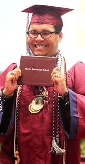 Nathanuel Allen Hunt is all smiles after receiving his diploma.
