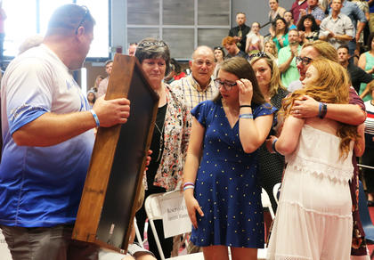 Kristi Martin presented a memorial shadow box to the family of Timothy Austin Smith, who passed away this school year in a car accident. Smith would have graduated alongside the rest of his class on May 25, 2019.
