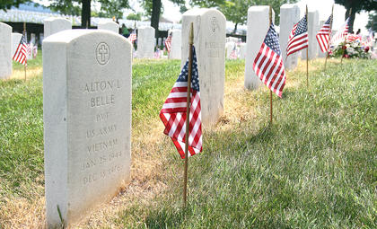 Each grave in the cemetery was decorated with a small American flag.