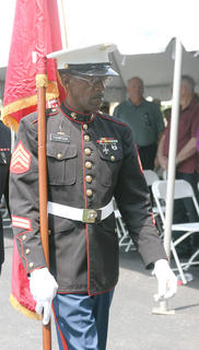 David Thompson of the Marion County Honor Guard carries the Marine Corps flag.