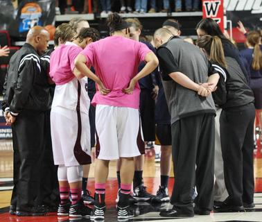 The captains of the Lady Knights meet at halfcourt before the state championship game.