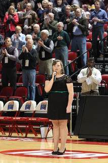 Marion County's Kellie Evans sings the National Anthem before the Lady Knights' second round game against Montgomery County.