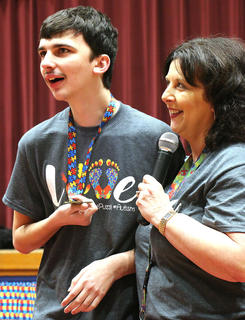 Evan Martin shares a special moment with his mother, Lisa Nally-Martin, during the Working the Puzzle for Autism event on Saturday at Marion County High School. Nally-Martin is the president of Working the Puzzle for Autism Inc., and she said her son, Evan, is who inspired her to create the organization and autism center in Lebanon.