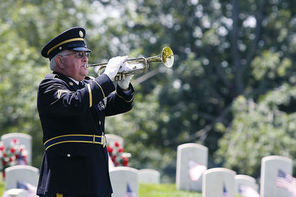 Joe Taylor plays Taps during the Memorial Day ceremony.