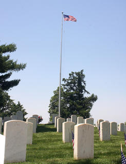 The American flag flies proudly at the cemetery.
