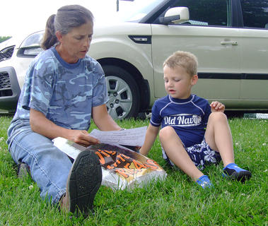 Lucas Durham, 5, and his grandmother Trina Gribbins check out the contents of the grab bag.