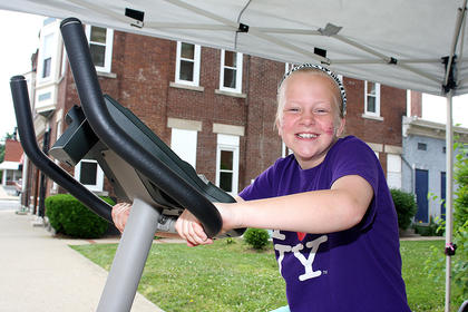 Ava Spalding decided to be different and exercised on a stationary bike instead of one of the treadmills.