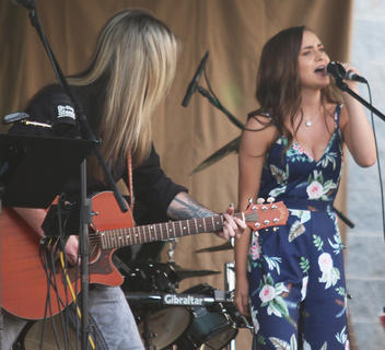 Abi Adams sings with help from Sticktight Akins, who backed her up on the accoustic guitar.