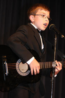 "Channing Young, 10, performs ""Man in Black"" by his favorite artist, Johnny Cash."