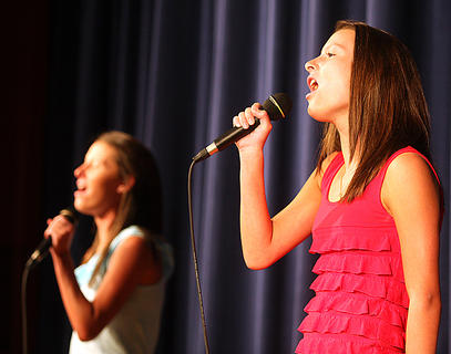 "Katelyn Daugherty and her twin sister, Samantha (pictured in the background) sing ""Young and Beautiful"" by Carrie Underwood. They received third place in the teen division."