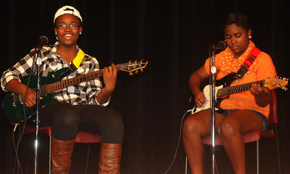 """Gypsy,"" which is comprised of sisters Arieyon and Jasmyne Smith, perform during the talent show. Jasmyne (left), 15, plays lead guitar and Arieyon, 13, plays bass."