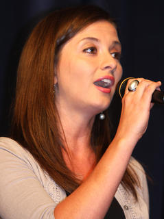 "Natalie Burdette performs ""Goodnight My Someone"" from ""The Music Man,"" which she will be performing in during the month of July in Campbellsville. She won first place in the adult division at the talent show."