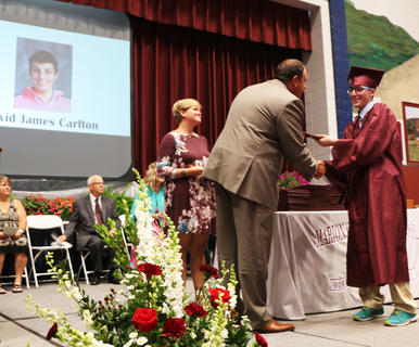 David Carlton receives his diploma.