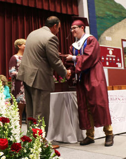 Jonathan Chesser receives his diploma.