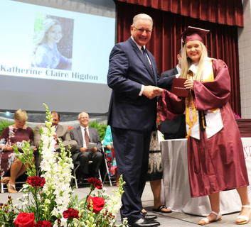 Claire Higdon receives her diploma.