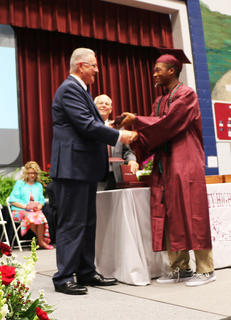 Lamontae Shively receives his diploma.