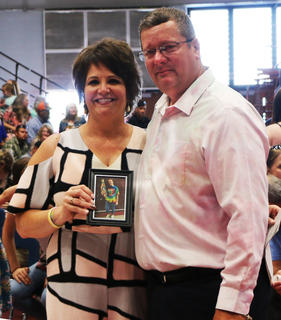 Parents of Olivia Ford, David and Jennifer Neireiter Ford, attend the 2018 MCHS graduation in honor of Olivia, who would have graduated that day.