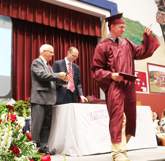 Bobbie Wilson receives his diploma.