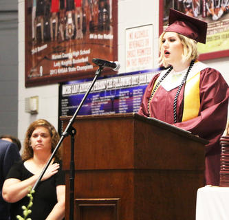 Laney Hall sings the National Anthem at MCHS 2018 commencement.