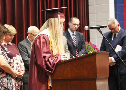 Claire Higdon gives the opening invocation during the MCHS 2018 commencement.