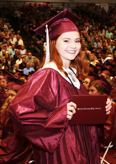 Olivia Lee poses with her diploma.