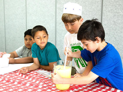 The 21st Century Learning Camp students visited the UK Cooperative Extension Office on May 30, and they used their marketing skills to become lemonade entrepreneurs. They also learned how to make a summer snack. Epzon Gomez, Mario Luna, Jackson Truitt and Angel Olivera try to make the best lemonade at their stand.
