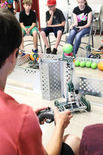 Students compete in a robotics competition as part of the Project Lead the Way Engineering Camp.