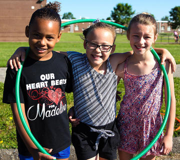 La'Miya Washington, Caylin Turner, and Avery Mattingly practice their hula hooping skills.
